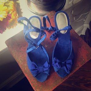 Blue suede bow tie heels